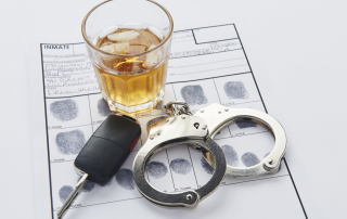 Handcuffs, drink and car keys