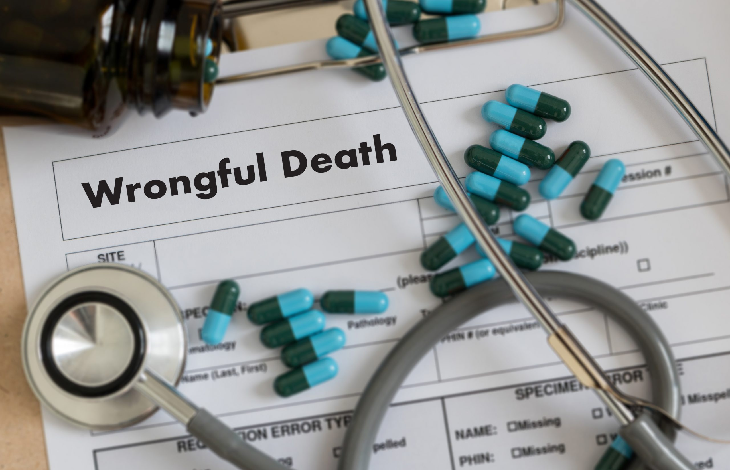 Wrongful death form, pills and a stethoscope