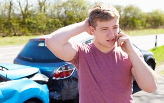 Man on phone after a rear-end accident