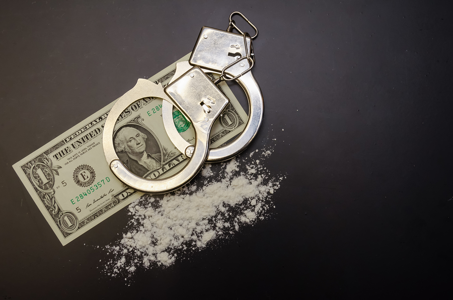 Drugs, handcuffs and money